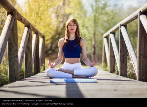 2311886-woman-doing-yoga-in-nature-lotus-figure-on-wooden-bridge-dot-photocase-stock-photo-large.jpeg